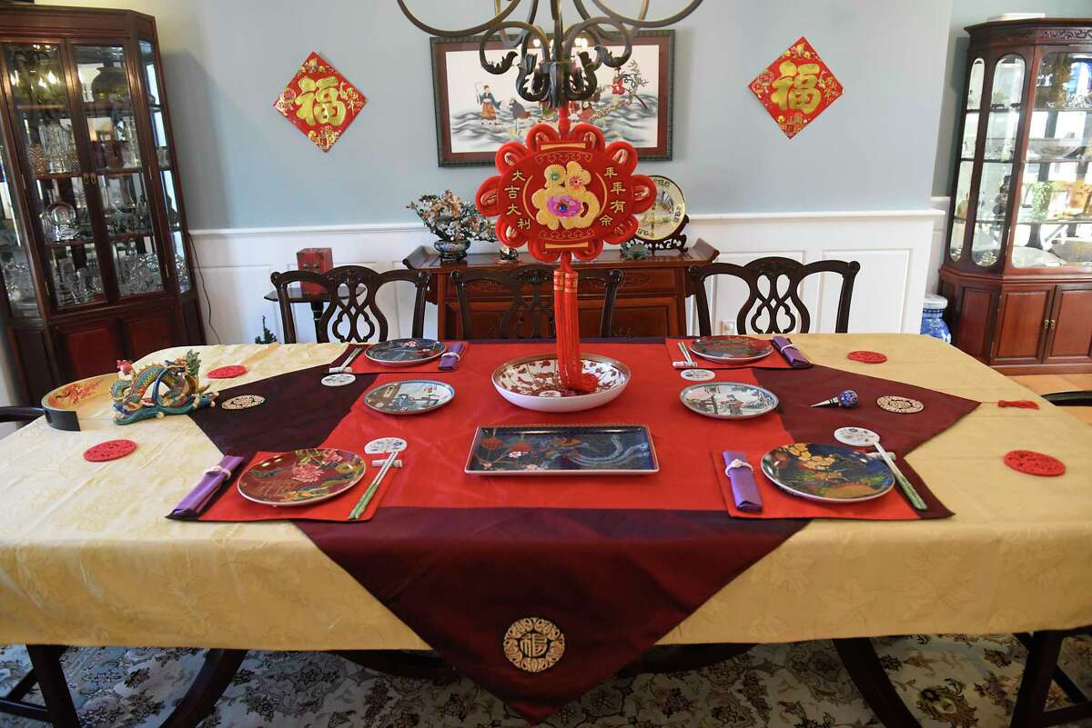 Wei Qin's elaborate traditional banquet table setting for the upcoming Chinese New Year holiday on Friday, Feb. 5, 2021 in Schenectady, N.Y. The holiday starts on begins Friday, Feb. 12. (Lori Van Buren/Times Union)