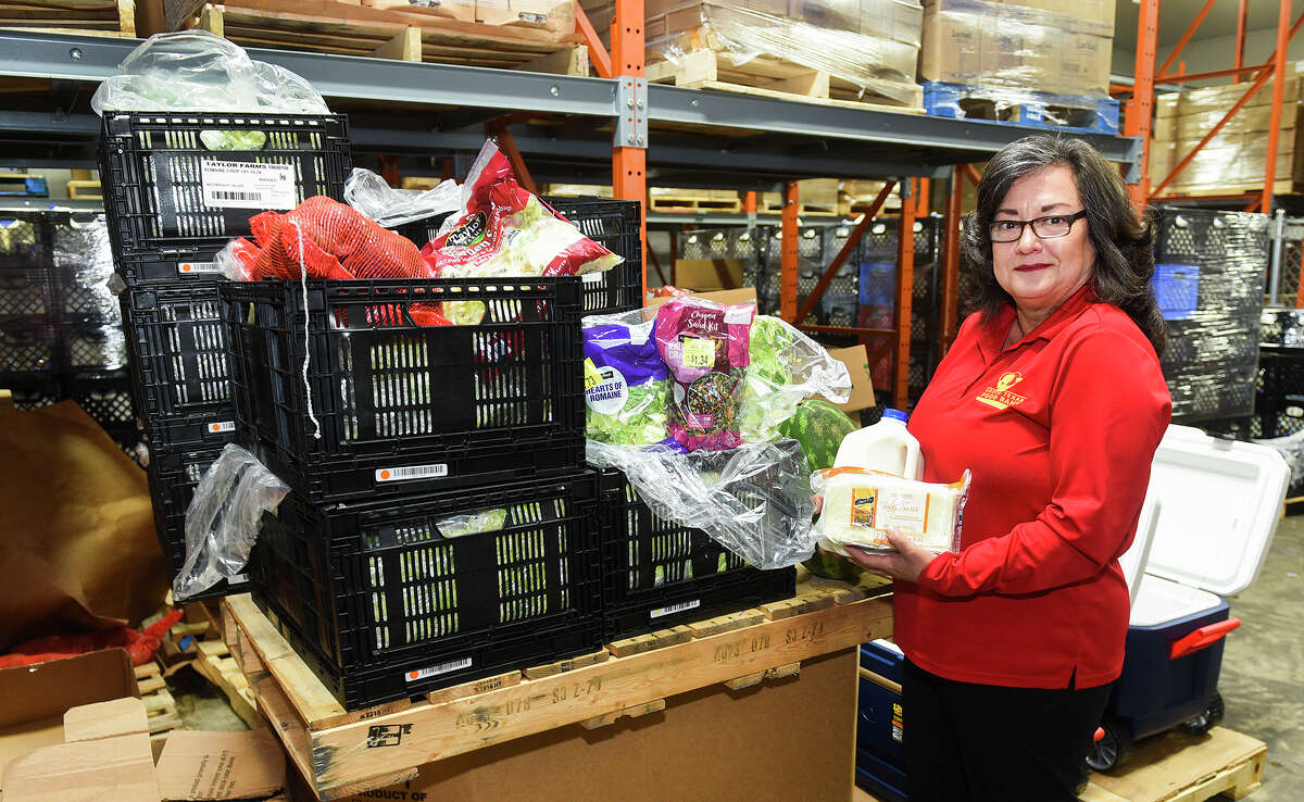 South Texas Food Bank Executive Director Alma Boubel poses for a photo, Friday, Jun 6, 2020, at the South Texas Food Bank, with some produce to be given out during the STFB's COVID-19 Emergency Distribution today at the Sames Auto Arena.