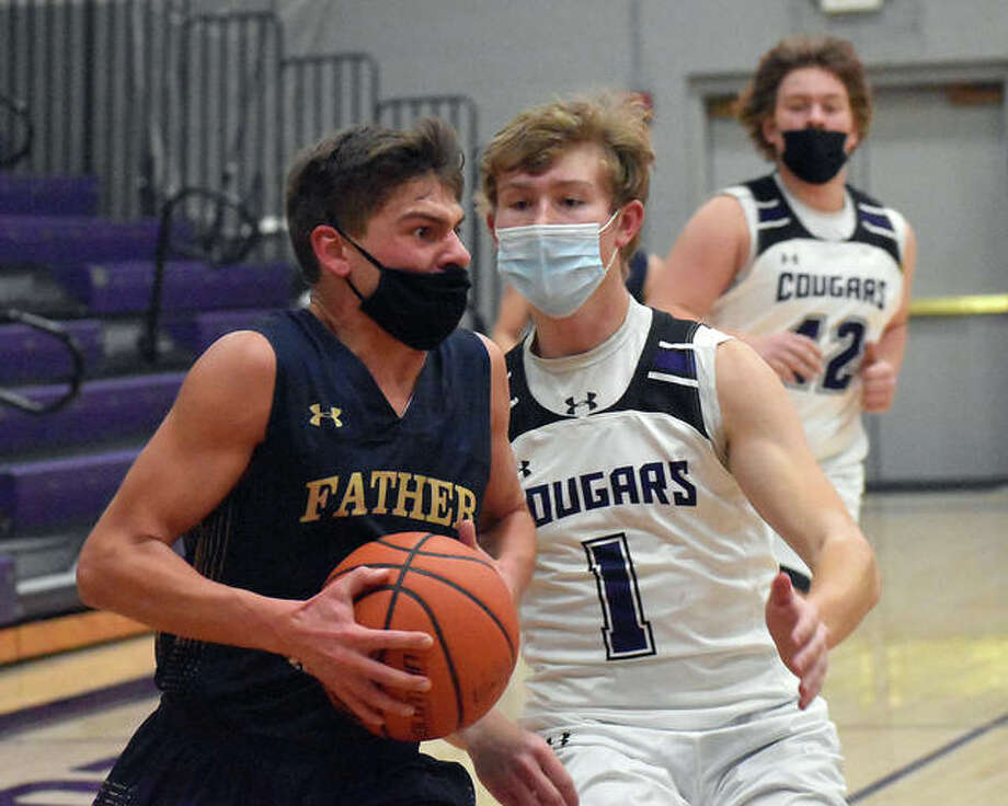 Father McGivney's Andrew Dupy drives to the basket after a steal at midcourt in the third quarter of Friday's game against Breese Central in Breese. Photo: Matt Kamp|The Intelligencer