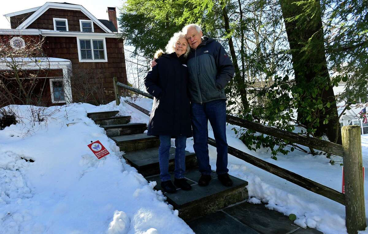 Kathleen Conway and Moten Anker at their home in Norwalk Thursday.