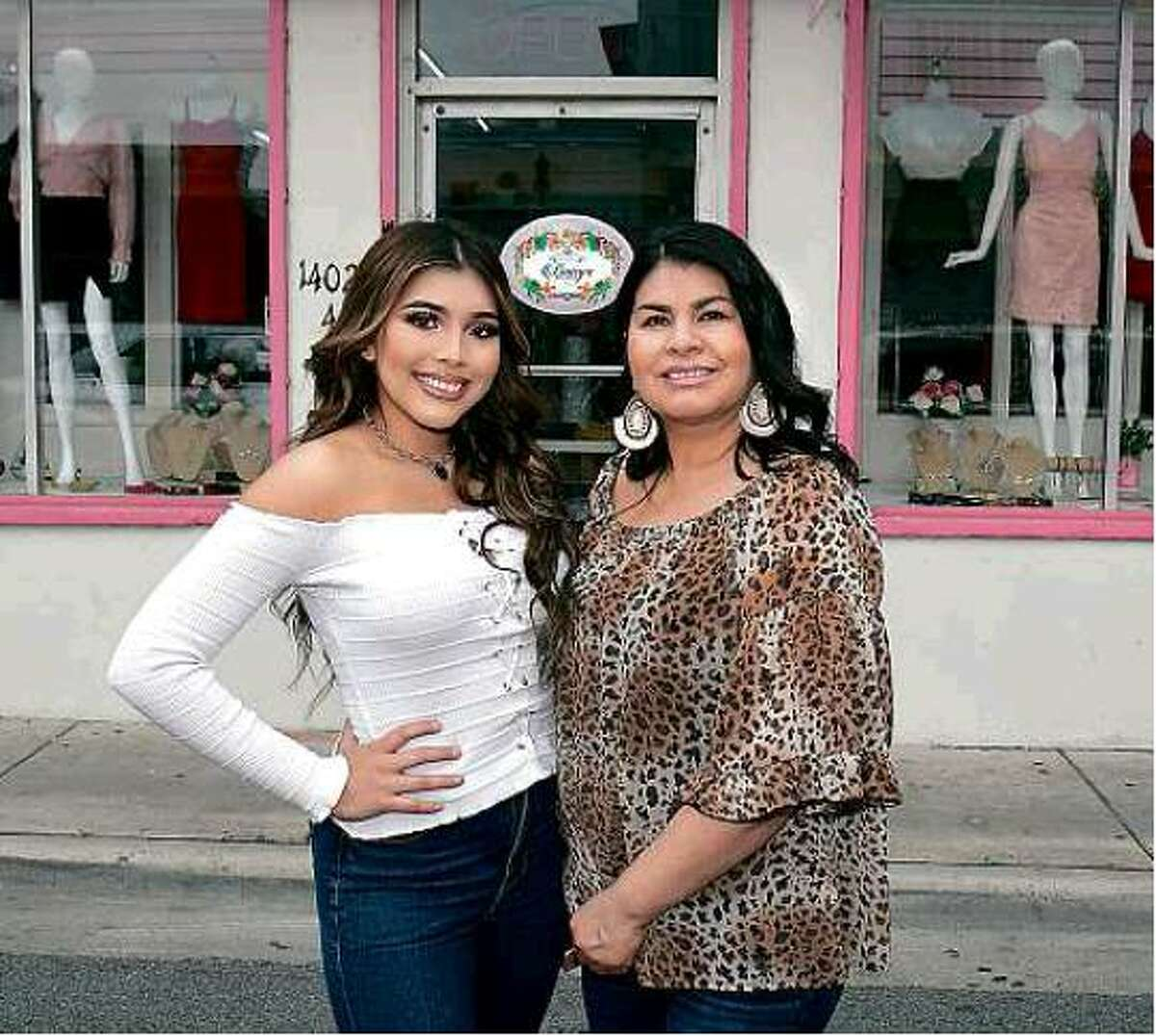 Daisy and Elizabeth Sandoval pose outside their store, Daisy's Boutique, in downtown Laredo.