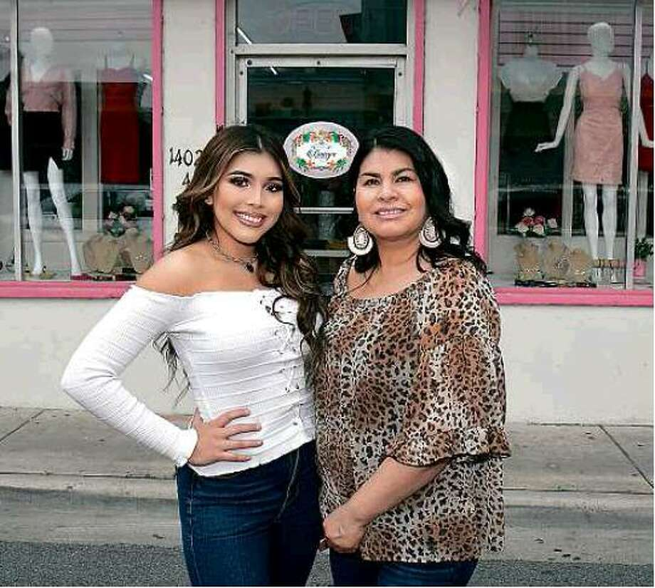 Daisy and Elizabeth Sandoval pose outside their store, Daisy's Boutique, in downtown Laredo. Photo: Cuate Santos/Laredo Morning Times