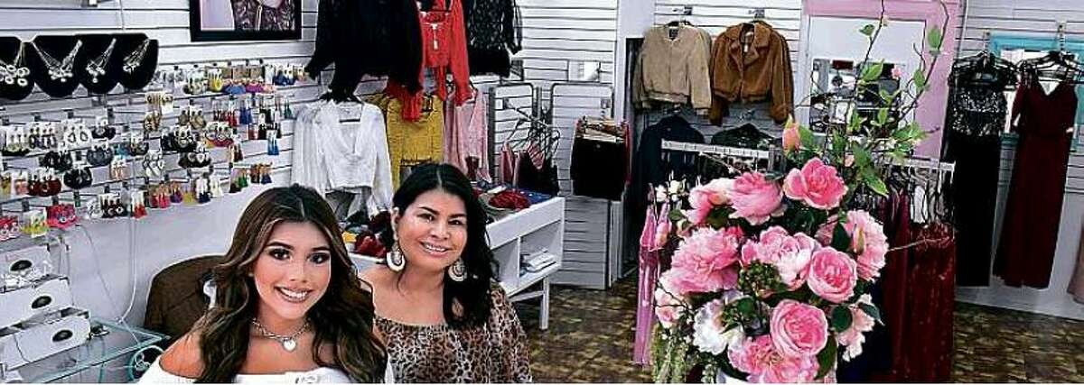 Daisy and Elizabeth Sandoval pose inside their store.