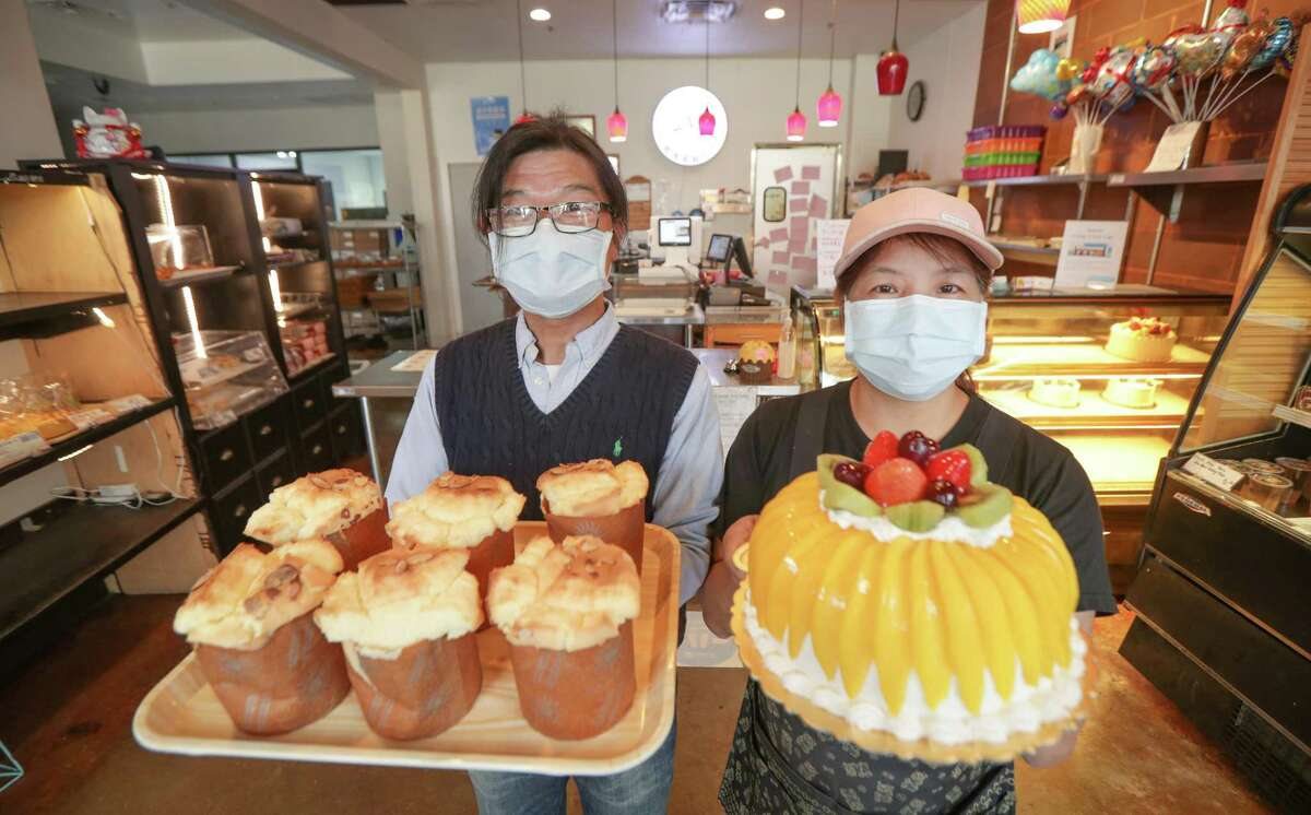 Shiann Lian and Amy Lin hold vanilla and pandan cupcakes and a magnolia cake at Kamalan Bakery 9889 Bellaire Blvd. Friday, Jan. 29, 2021, in Houston.