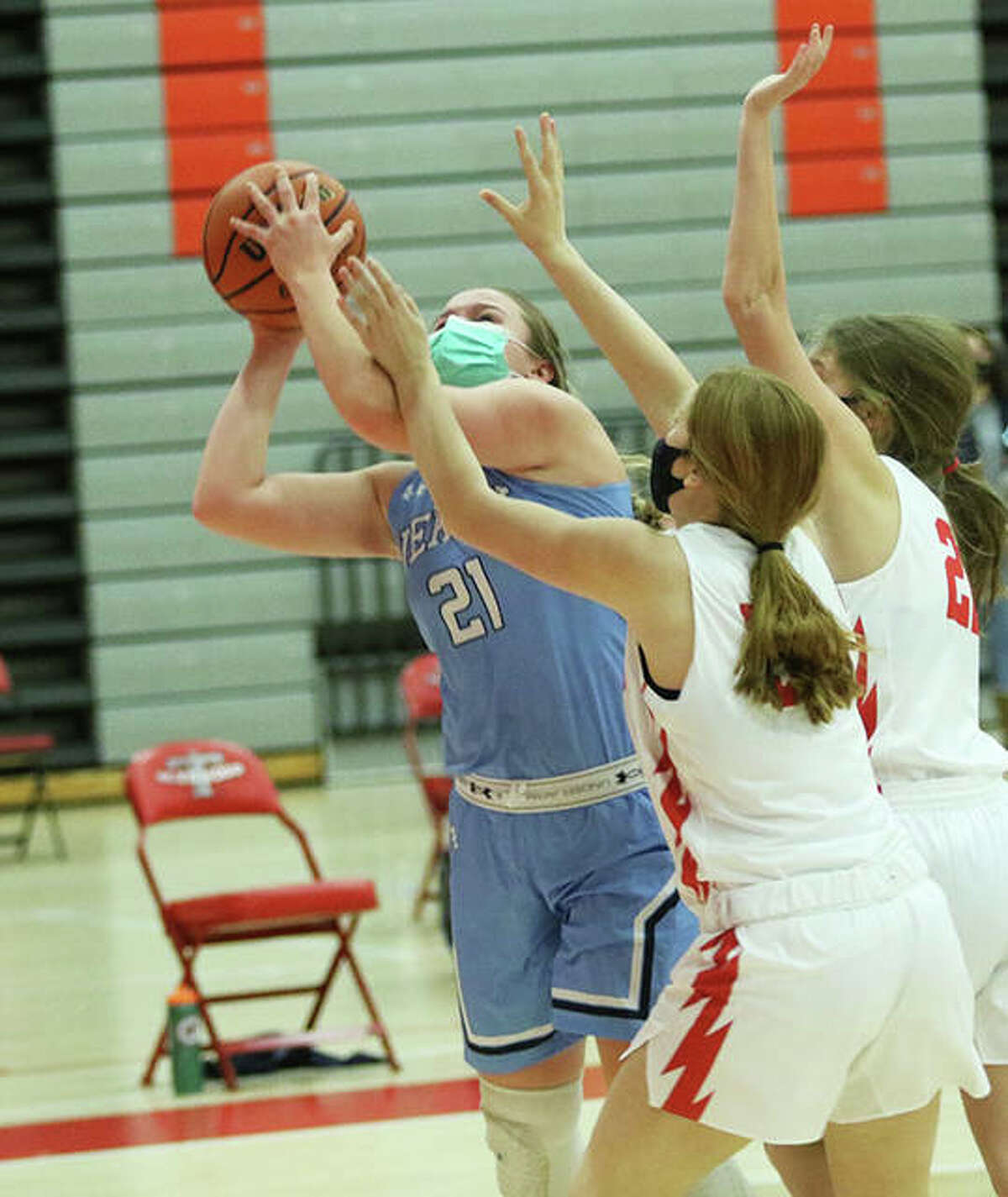Jersey's Boston Talley (21) shoots over two Chatham Glenwood defenders during the second half of the Panthers' win Friday night at Chatham.