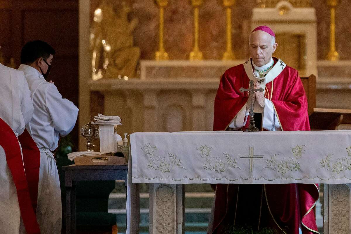 """San Francisco's Archbishop Salvatore Joseph Cordileone holds mass services at Church of Saint Raphael in San Rafael, Calif. Saturday, October 17, 2020. He said worshipers were now free of """"harassment from government officials"""" after a Supreme Court decision to overturn a California ban on religious services."""