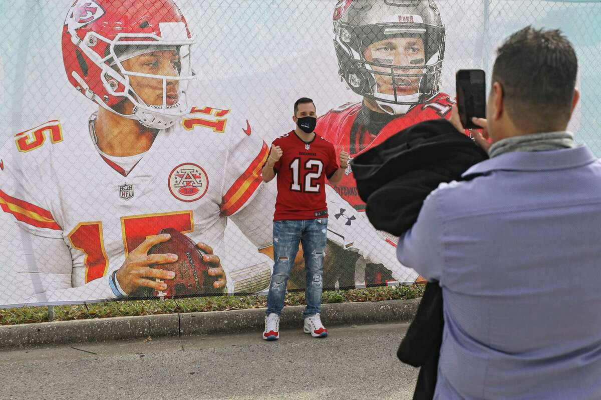TAMPA, FLORIDA - FEBRUARY 06: A football fan poses for a picture prior to Super Bowl LV outside of Raymond James Stadium on February 6, 2021 in Tampa, Florida. The Kansas City Chiefs featuring Patrick Mahomes will play Tampa Bay Buccaneers who feature Tom Brady at Raymond James Stadium. (Photo by Patrick Smith/Getty Images)