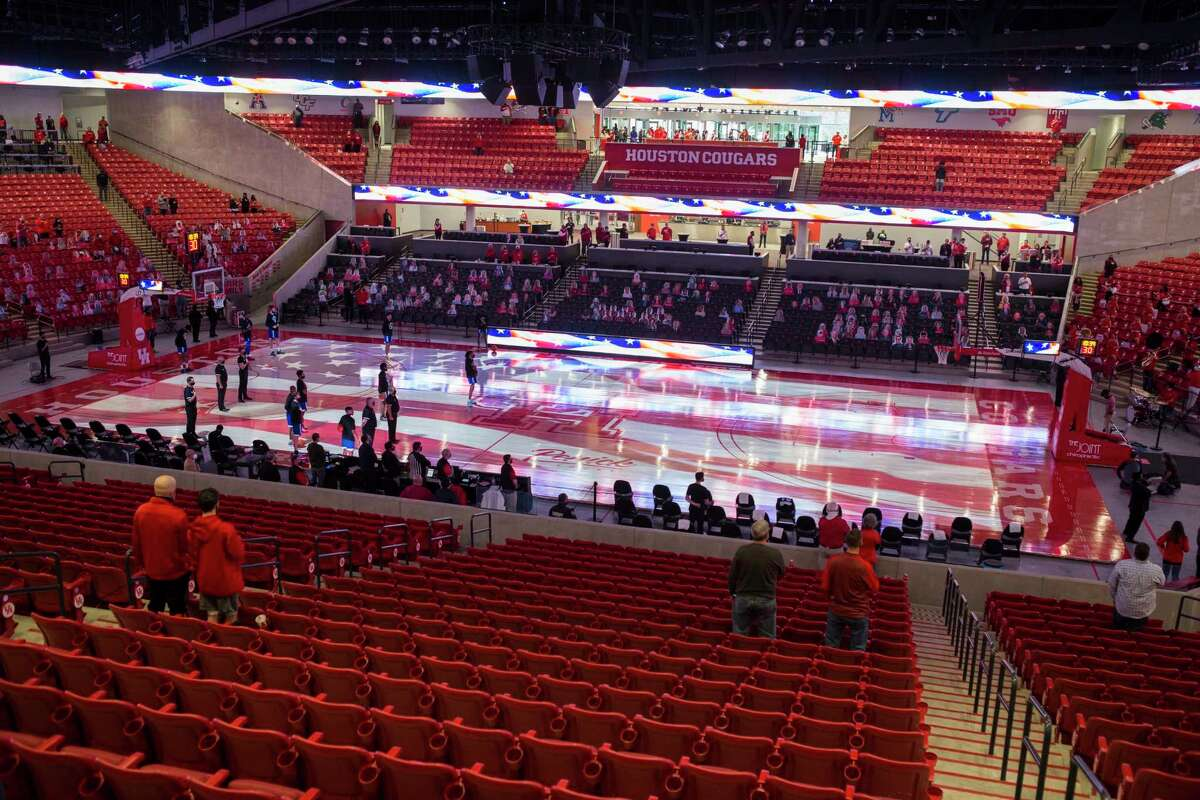 A sparse crowd stands for the National Anthewm before and NCAA basketball game between Houston and Our Lady of the Lake at Fertitta Center Saturday, Feb. 6, 2021, at Fertitta Center in Houston.