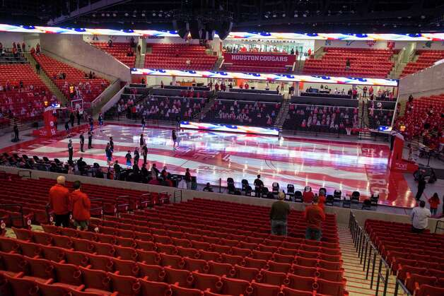 A sparse crowd stands for the National Anthewm before and NCAA basketball game between Houston  and Our Lady of the Lake at Fertitta Center Saturday, Feb. 6, 2021, at Fertitta Center in Houston. Photo: Brett Coomer, Staff Photographer / © 2021 Houston Chronicle