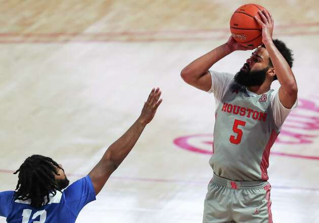 Houston guard Cameron Tyson (5) takes a shot over Our Lady of the Lake guard Darin Minniefield (10) during the second half on a NCAA basketball game Saturday, Feb. 6, 2021, at Fertitta Center in Houston. UH won the game 112-46. Photo: Brett Coomer, Staff Photographer / © 2021 Houston Chronicle