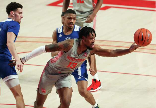 Houston forward J'Wan Roberts (13) reaches out to grab a loose ball against Our Lady of the Lake during the second half on a NCAA basketball game Saturday, Feb. 6, 2021, at Fertitta Center in Houston. UH won the game 112-46. Photo: Brett Coomer, Staff Photographer / © 2021 Houston Chronicle