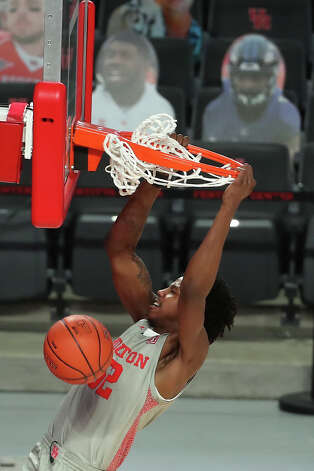 Houston center Kiyron Powell (52) scores on a break-away dunk against Our Lady of the Lake during the second half on a NCAA basketball game Saturday, Feb. 6, 2021, at Fertitta Center in Houston. UH won the game 112-46. Photo: Brett Coomer, Staff Photographer / © 2021 Houston Chronicle