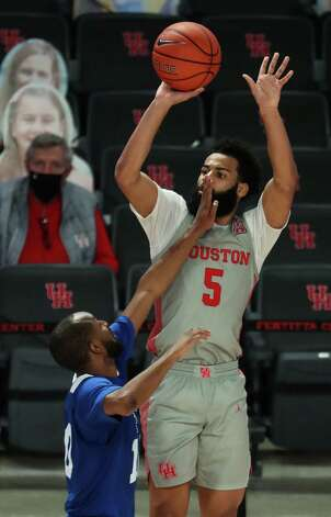 Houston guard Cameron Tyson (5) shoots a 3-pointer over Our Lady of the Lake guard Darin Minniefield (10) during the second half on a NCAA basketball game at Fertitta Center Saturday, Feb. 6, 2021, in Houston. UH won the game 112-46. Tyson's 3 gave him 10 for the game, a single game school record for 3-pointers. Photo: Brett Coomer, Staff Photographer / © 2021 Houston Chronicle