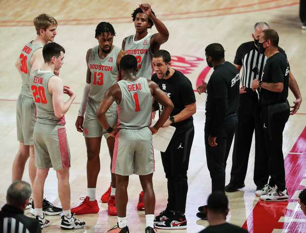 Houston assistant coach Kellen Sampson works with the Cougars players during a time out in the second half on a NCAA basketball game Saturday, Feb. 6, 2021, at Fertitta Center in Houston. UH won the game 112-46. Photo: Brett Coomer, Staff Photographer / © 2021 Houston Chronicle