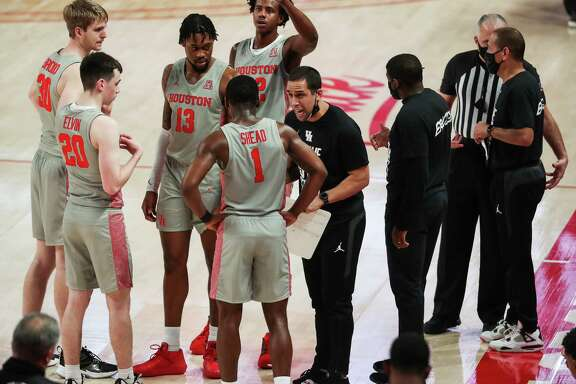 Houston assistant coach Kellen Sampson works with the Cougars players during a time out in the second half on a NCAA basketball game Saturday, Feb. 6, 2021, at Fertitta Center in Houston. UH won the game 112-46.