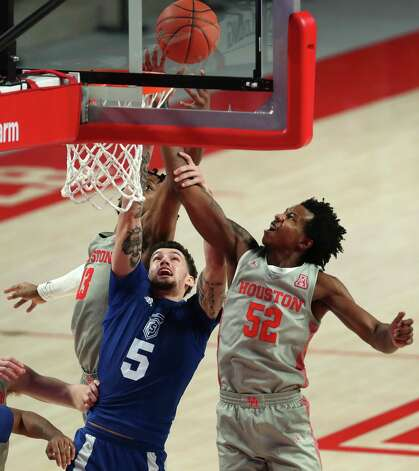 Houston forward J'Wan Roberts (13), Our Lady of the Lake forward Ruben Monzon (5) and Houston center Kiyron Powell (52) tight for a rebound during he second half on a NCAA basketball game Saturday, Feb. 6, 2021, at Fertitta Center in Houston. UH won the game 112-46. Photo: Brett Coomer, Staff Photographer / © 2021 Houston Chronicle