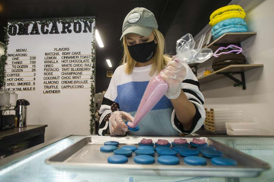 Kodi O'Mara fills blueberry-flavored macarons Friday inside O'Macaron, the new bakery she owns, located at 128 Townsend St. in Midland. (Katy Kildee/kkildee@mdn.net) Photo: (Katy Kildee/kkildee@mdn.net)