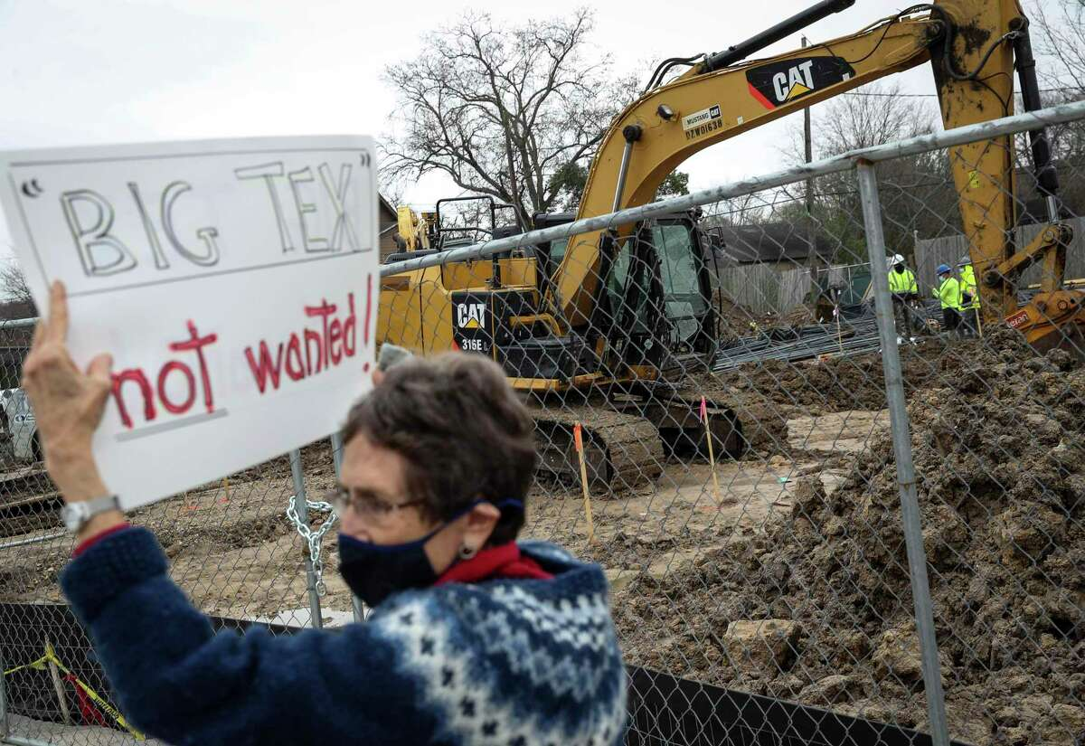 Mary Schultz protests the construction of a Big Tex Storage building on Saturday long East 11th Street in the Heights. Schultz said she had lived in the neighborhood since 1977.