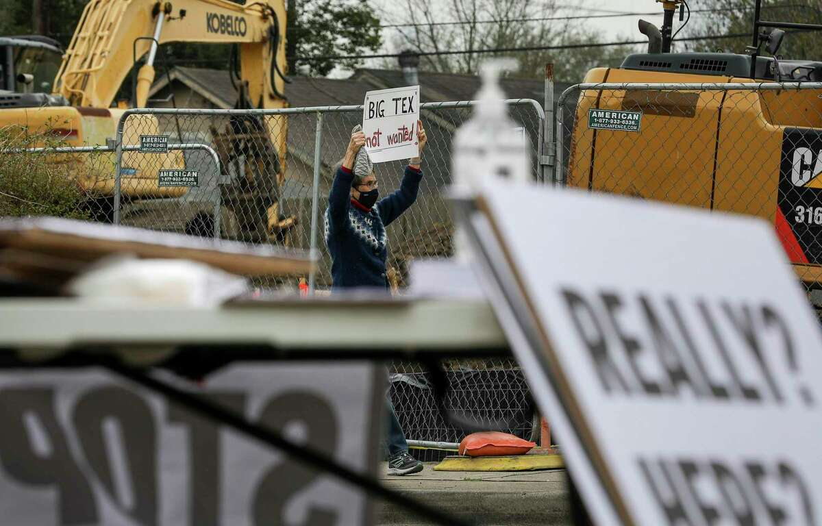 Mary Schultz protests the construction of a Big Tex Storage building Saturday, Feb. 6, 2021, along East 11th Street in the Heights neighborhood in Houston. Schultz said she had lived in the neighborhood since 1977.