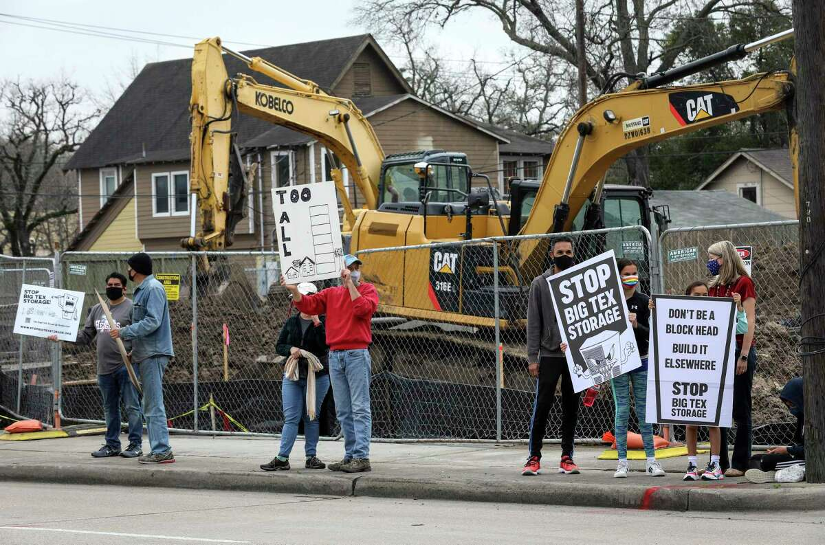 People protest the construction of a Big Tex Storage building Saturday, Feb. 6, 2021, along East 11th Street in the Heights neighborhood in Houston.