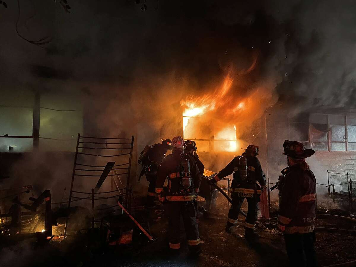 An early morning fire on Saturday that started at a homeless camp caused extensive damage to an Oakland community center.