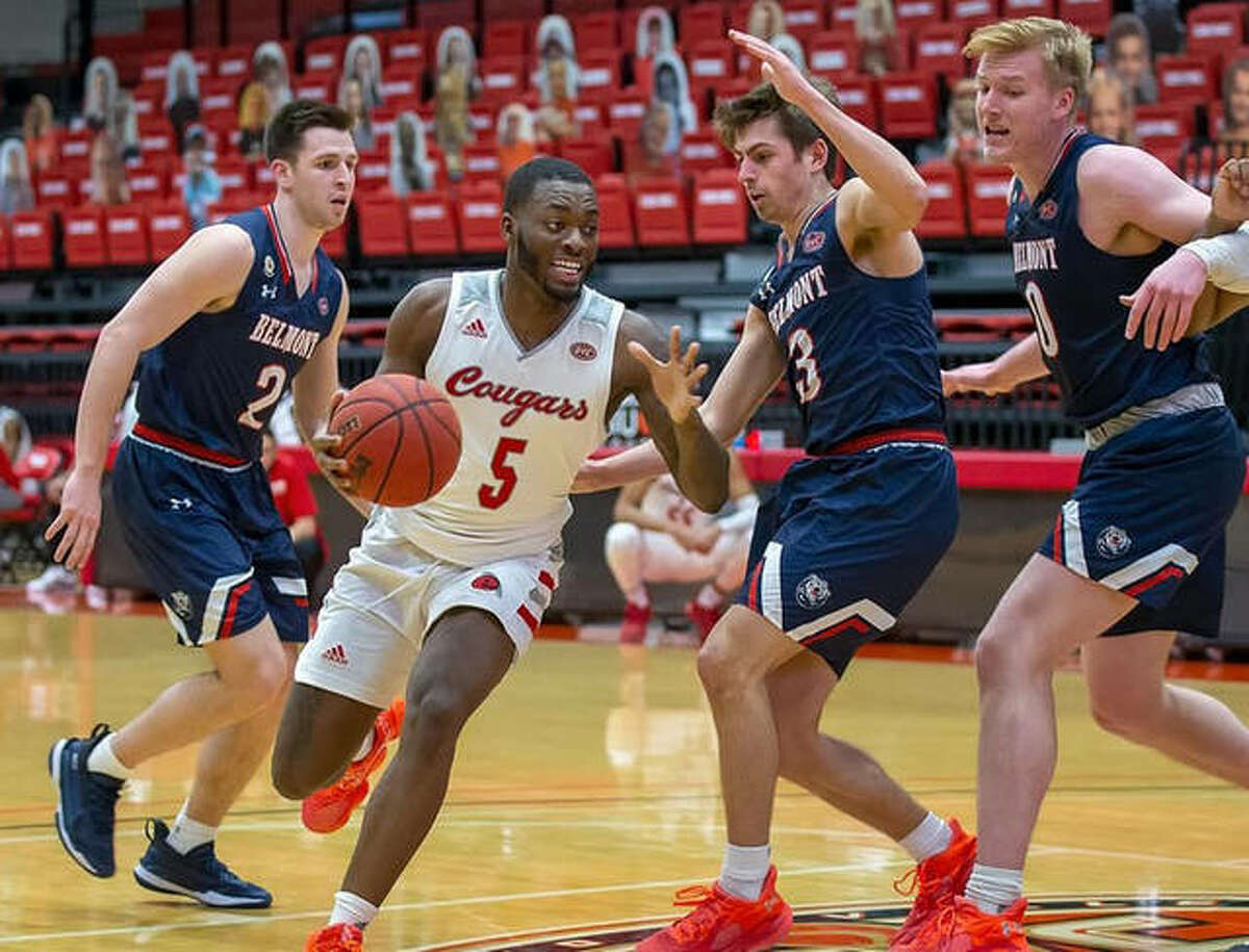 SIUE guard Carlos Curtis attempts to cut to the basket against a trio of Belleville West defenders during Saturday's game inside First Community Arena.