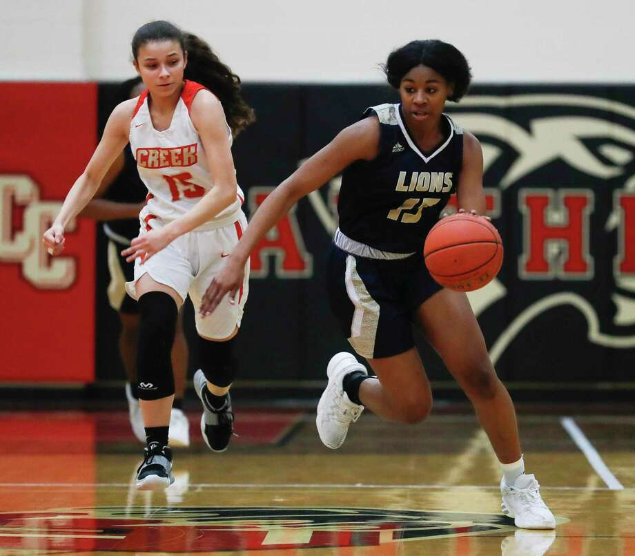Lake Creek point guard Taliyah Mcshan (15) starts a fast break during the first quarter of a high school basketball game at Caney Creek High School, Saturday, Feb. 6, 2021, in Grangerland. Photo: Jason Fochtman, Houston Chronicle / Staff Photographer / 2021 © Houston Chronicle