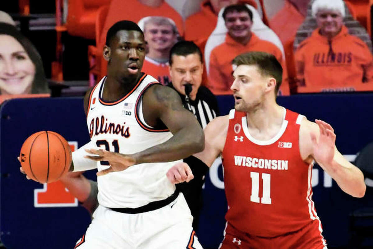 Illinois center Kofi Cockburn (21) controls the ball as he is pressured by Wisconsin's forward Micah Potter (11) in the first half of an NCAA college basketball game Saturday, Feb. 6, 2021, in Champaign, Ill.