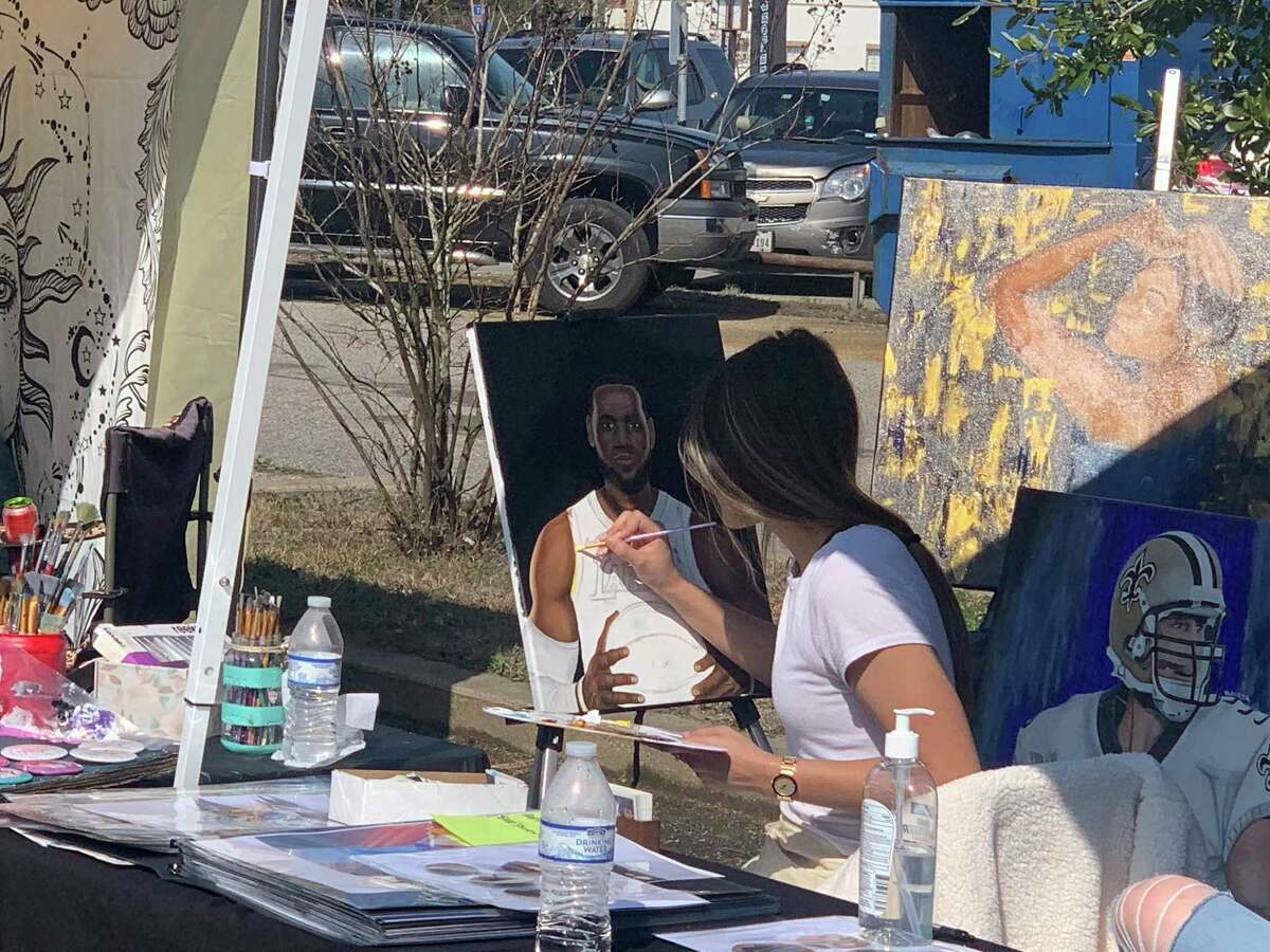 An artist painting a picture of Lebron James during the 8th annual New Orleans on Orleans street on Saturday, Feb. 6, 2021 in Beaumont, TX. The Enterprise/ Ramos