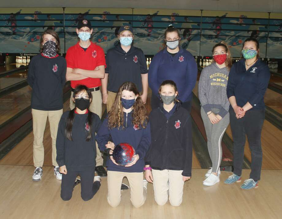 The Manistee Catholic Central bowling team. Pictured (from left to right) in the front row: Josie Fischer, Holly Riley-Lampinen and Lila-Ann Bechtel. Back row: Jamie Riley-Lampinen, Jacob Pete, Ian Madsen, Madison Antal, Cameryn Sutcliffe and Kaya Watkins. Photo: Dylan Savela/News Advocate