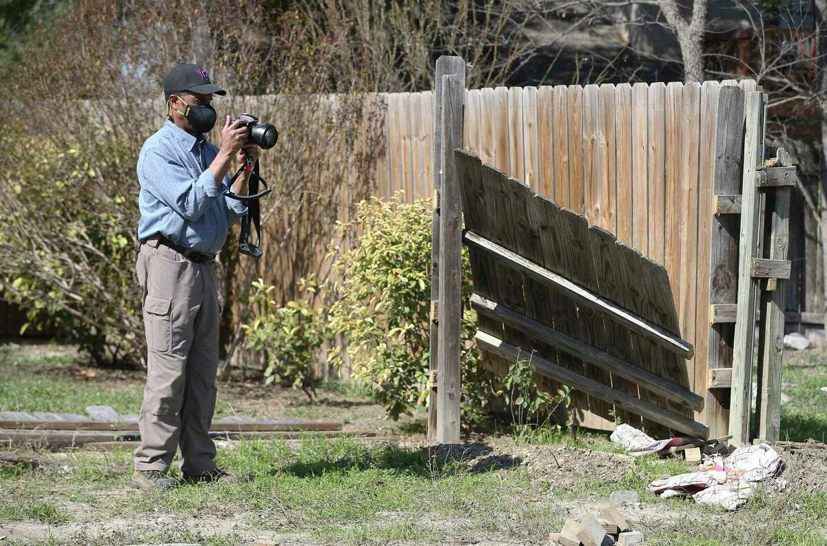 Landscape architect and historian Everett Fly documents the removal of fencing on the grounds of the Hockley-Clay Cemetery. Contractors moved the fences of residents whose property overlapped to the cemetery that Fly discovered in a Northeast Side neighborhood on Thursday, Feb. 4, 2021.