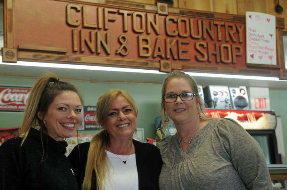 """R & R Clifton Country Inn's Emily Augenbaugh, owner Renee Goodpasture, and Jennifer McCoy welcomed a full house of diners Saturday. """"It feels so amazing. I haven't seen it like this in a year,"""" said Goodpasture."""