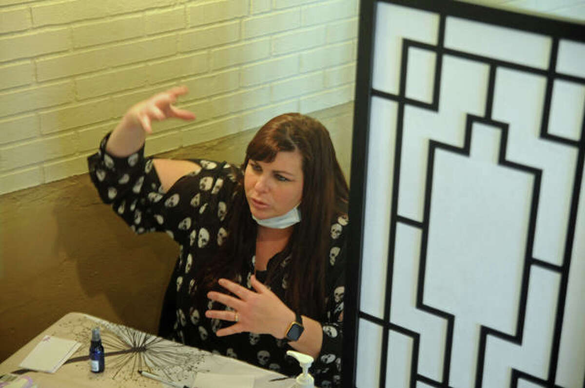 Psychic medium Andrea Hullman gives a reading during the Dead of Winter Festival. Paranormal fans celebrated ghosts, hauntings, folklore and legends during the 23rd annual American Hauntings-sponsored event in the Mineral Springs Hotel.