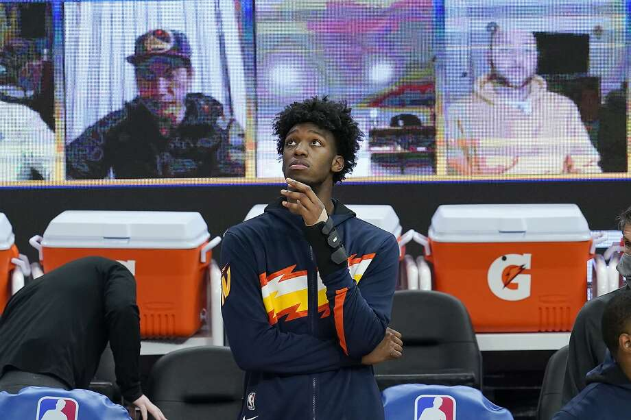 Injured Golden State Warriors center James Wiseman watches players warm up for an NBA basketball game between the Warriors and the Boston Celtics in San Francisco, Tuesday, Feb. 2, 2021. (AP Photo/Jeff Chiu) Photo: Jeff Chiu / Associated Press