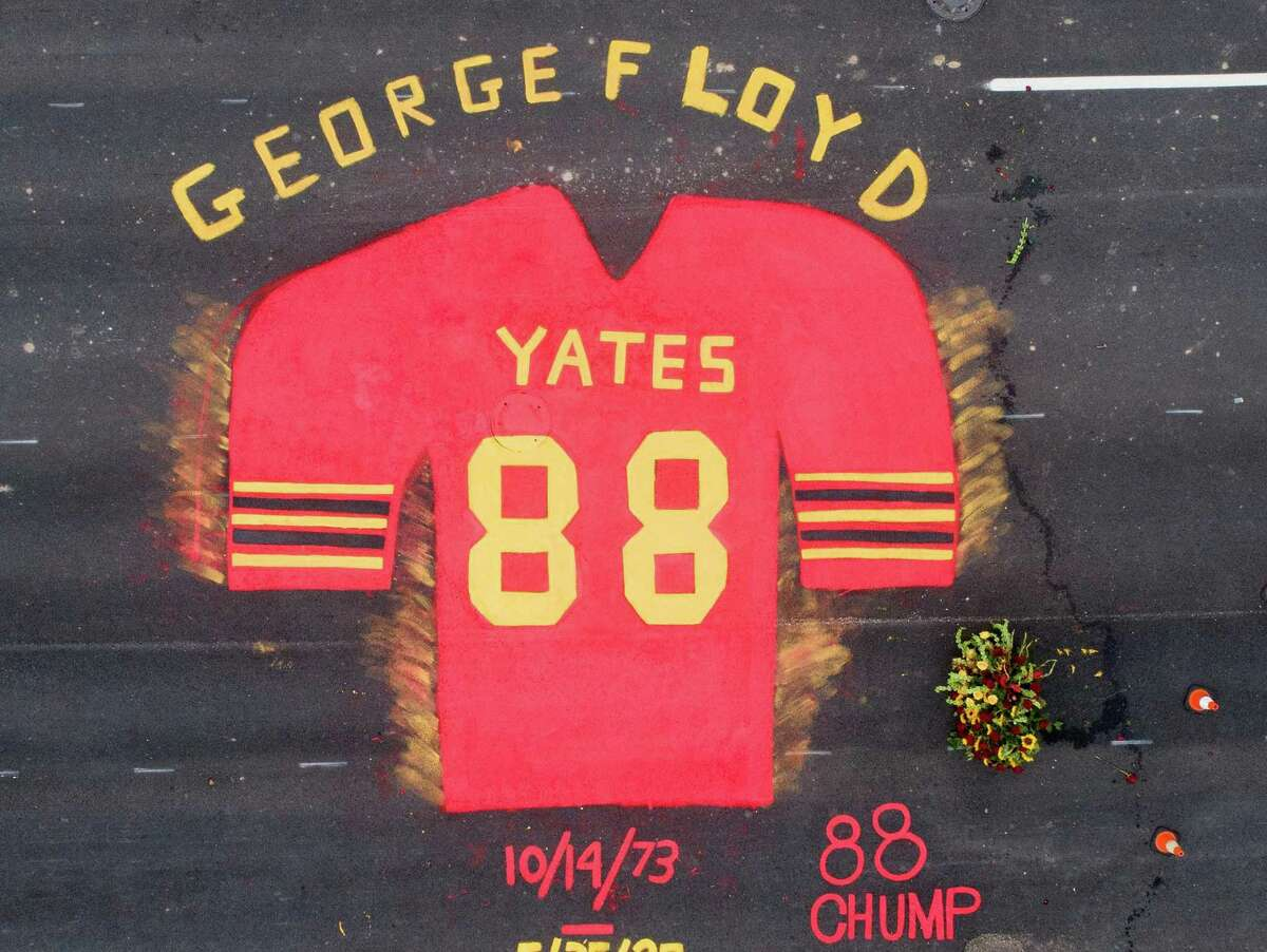 Part of the mural by Third Ward native Jonah Elijah in honor of Black History Month and George Floyd in front of Jack Yates High School in Houston on Saturday, Feb. 6, 2021.
