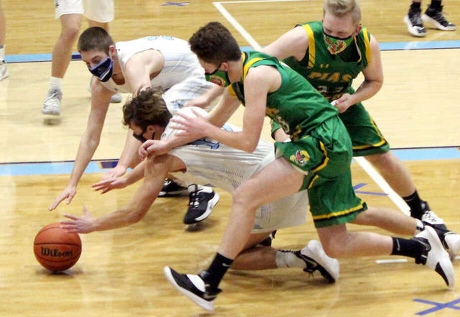 Players from Southwestern and Jersey scramble for the ball in the second half of Saturday's game at Havens Gym in Jerseyville. Jersey's Logan Schultz has his hand on the ball while teammate Sam Lamer reaches in from the back. Southwestern's Addis Moore is at center in green and teammate David Watkins is far right. Photo: Pete Hayes   The Telegraph