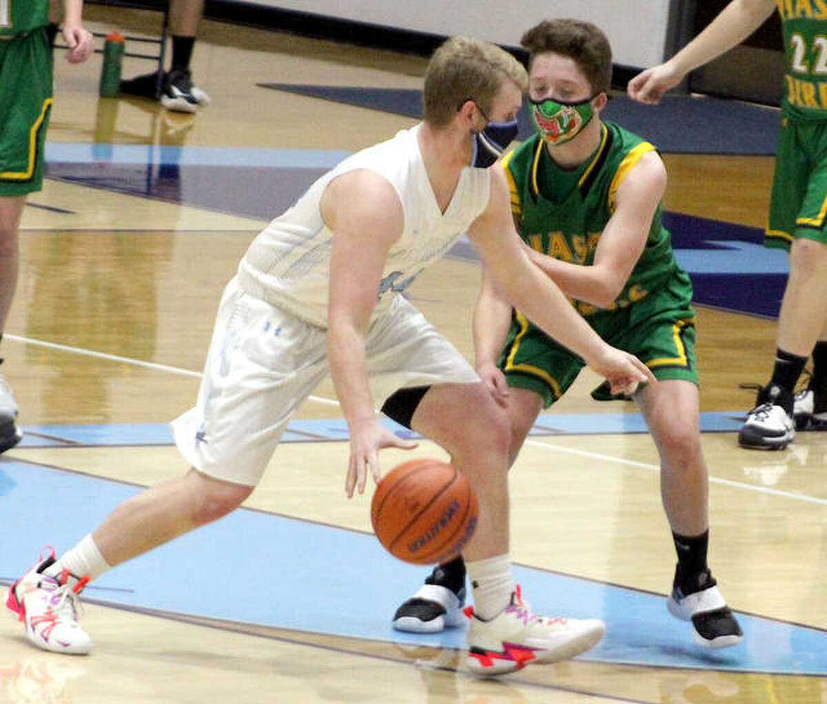 CJ Brunaugh of Jersey dribbles against Southwestern's Charlie Darr Saturday in Jerseyville.