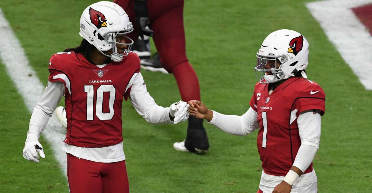 Kyler Murray #1 of the Arizona Cardinals celebrates with DeAndre Hopkins #10 after scoring his second touchdown of the game against the Washington Football Team during the fourth quarter at State Farm Stadium on September 20, 2020 in Glendale, Arizona. Cardinals won 30-15. (Photo by Norm Hall/Getty Images)