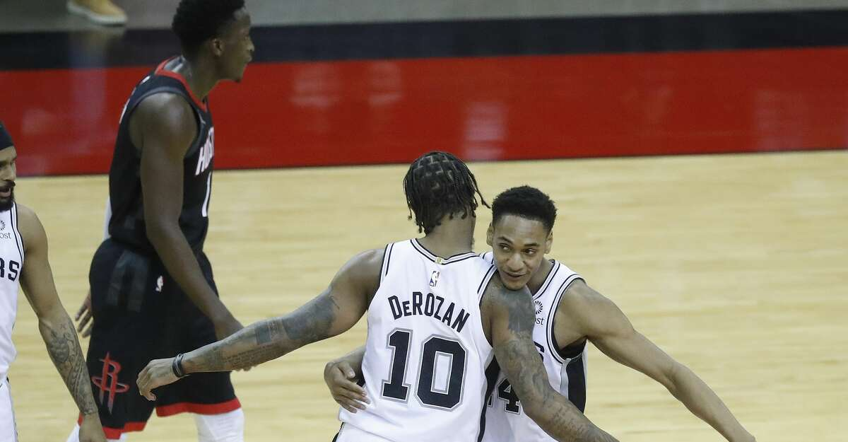 San Antonio Spurs guard Devin Vassell (24) celebrates a ten-point lead with forward DeMar DeRozan (10) after he dunked the ball against the Houston Rockets during the second half of an NBA basketball game at Toyota Center, in Houston, Saturday, Feb. 6.