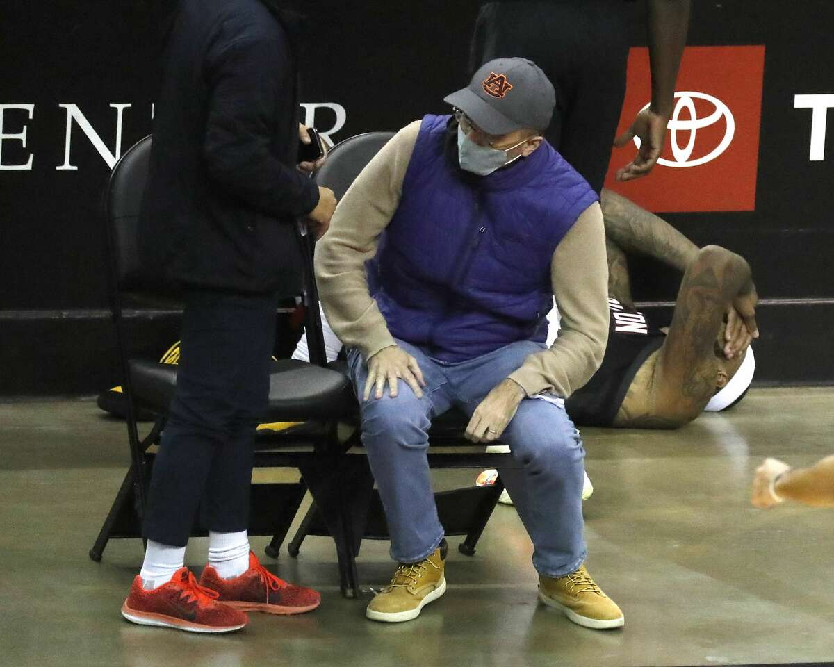 Houston Rockets center DeMarcus Cousins (15) holds his head after crashing into a wall off court during the second half of an NBA basketball game at Toyota Center, in Houston, Saturday, Feb. 6.