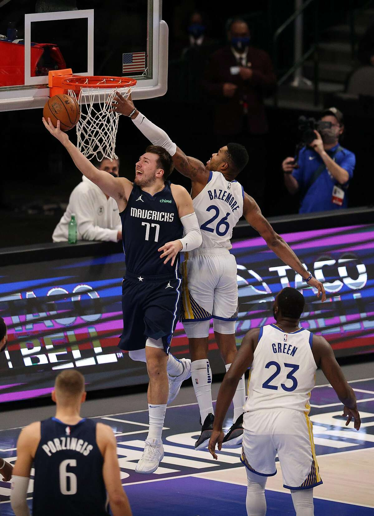 DALLAS, TEXAS - FEBRUARY 06: Luka Doncic #77 of the Dallas Mavericks takes a shot against Kent Bazemore #26 of the Golden State Warriors in the second quarter at American Airlines Center on February 06, 2021 in Dallas, Texas. NOTE TO USER: User expressly acknowledges and agrees that, by downloading and/or using this photograph, user is consenting to the terms and conditions of the Getty Images License Agreement. (Photo by Ronald Martinez/Getty Images)