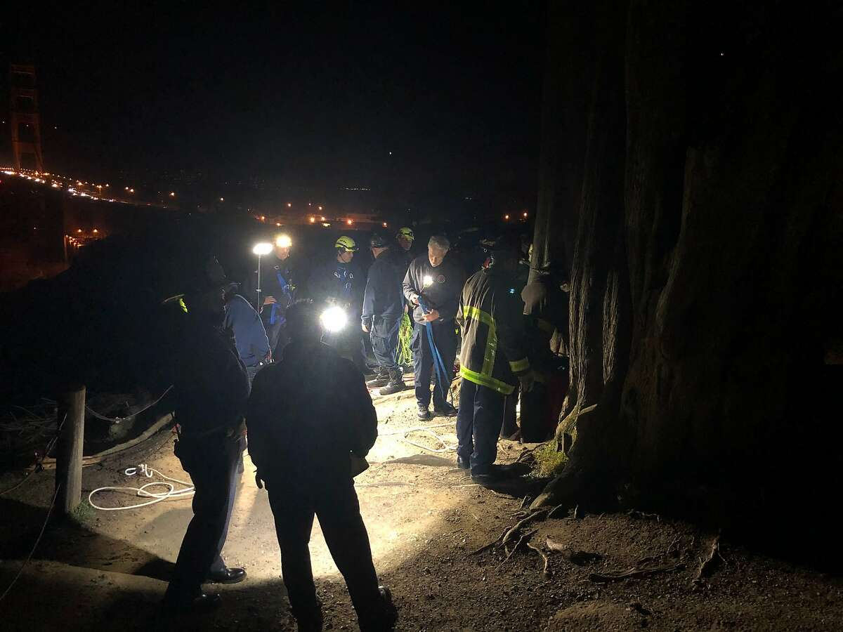 San Francisco firefighters rescued two teenagers at Marshall's Beach, where they were hoisted up a roughly 100-foot cliff after they likely got trapped after the tide came in, San Francisco Fire Department Lt. Jonathan Baxter told The Chronicle.