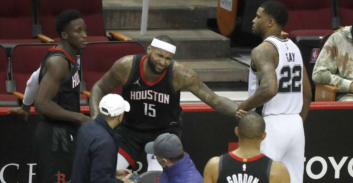 Houston Rockets center DeMarcus Cousins (15) is helped up after crashing into a wall off court during the second half of an NBA basketball game at Toyota Center, in Houston, Saturday, Feb. 6.