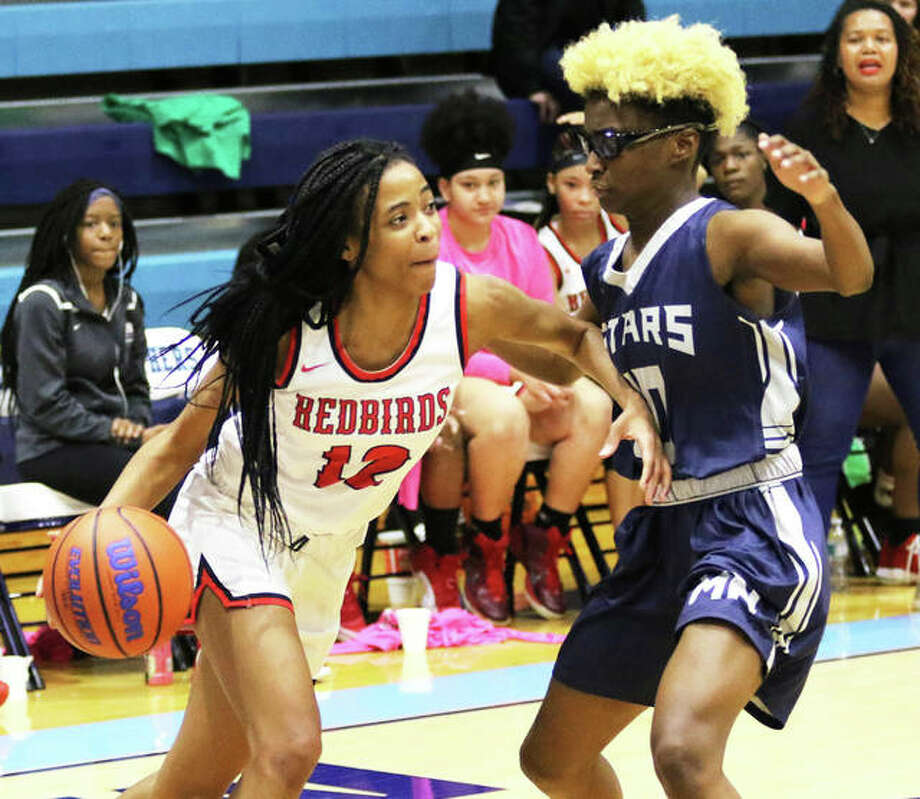 Alton's Germayia Wallace (left), shown in a game last season, had 19 points to lead the Redbirds to a SWC victory over Collinsville on Saturday at Fletcher Gym in Collinsville. Photo: Telegraph File