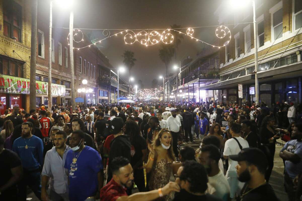 TAMPA, FL - FEBRUARY 07: Large crowds gather in the Ybor City district on the eve Super Bowl LV on February 7, 2021 in Tampa, Florida. In addition to social social distancing, the City of Tampa and the NFL have encouraged the general public to wear a mask and properly sanitize during Super Bowl weekend festivities. (Photo by Octavio Jones/Getty Images)