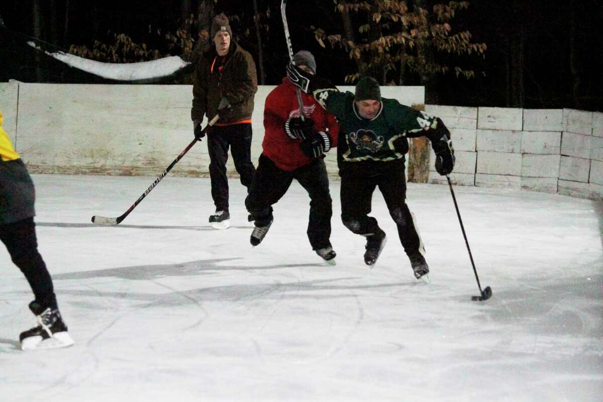 Scott Barker has been hosting pick-up hockey games at his ice rink five nights a week this winter. (Robert Myers/News Advocate)