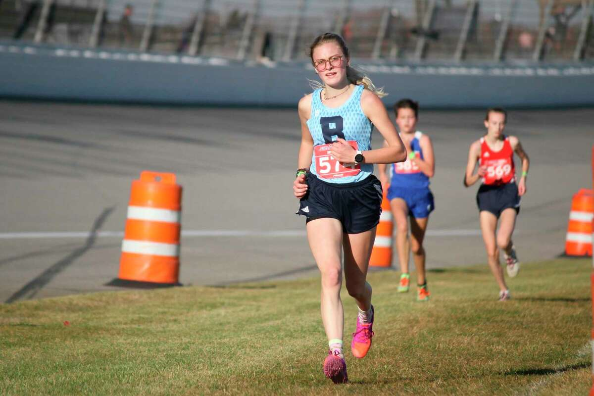 Alexis Tracy races down the final straightaway at the 2020 cross country state finals. (News Advocate file photo)