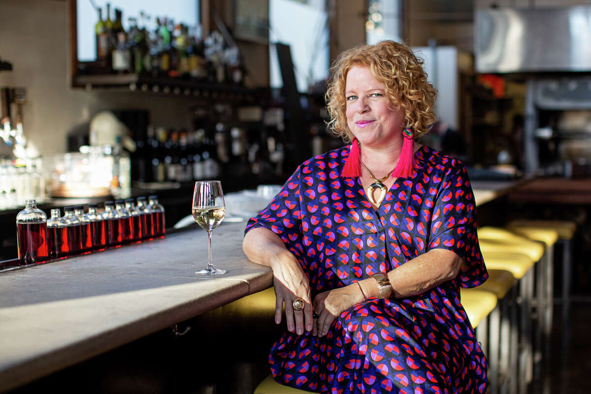 Marcia Gagliardi, shown in a closed restaurant and socially distanced from the photographer, is celebrating 15 years of writing her food e-column, Tablehopper.