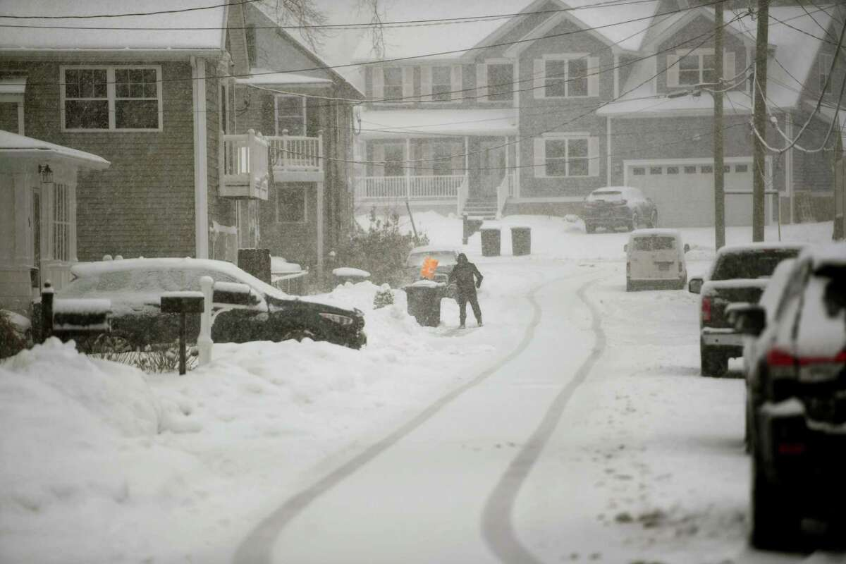 A file photo of a snow-covered Park Avenue in Miford, Conn., on Sunday, February 7, 2021 at the height of a storm that dropped 4 to 9 inches across the state.