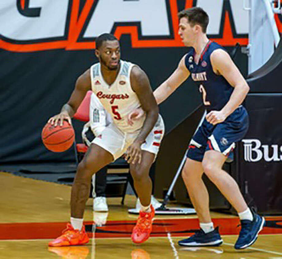 SIUE's Carlos Curtis (left) handles the ball against Belmont's Grayson Murphy on Saturday at First Community Arena in Edwardsville. Photo: SIUE Athletics
